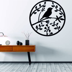 A wooden painting on a wall of plywood is already spring bird bird.