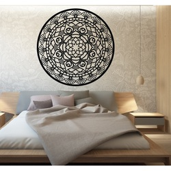 The mandala of life is rounded by a wooden picture on a wall made of SUSEN