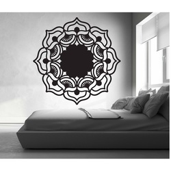 The rose of life rose round a wooden picture on a plywood wall MIREK