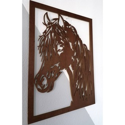 Carved painting on a wall of a wooden plywood head horse
